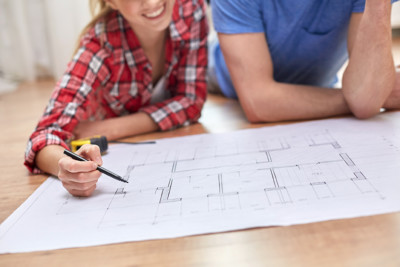 Couples reviewing architectural plans